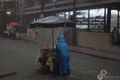 10A-Working-under-the-rain-Sukhumvit-Soi-11
